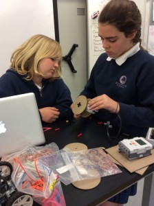 6th grade students designing wheels for their robot