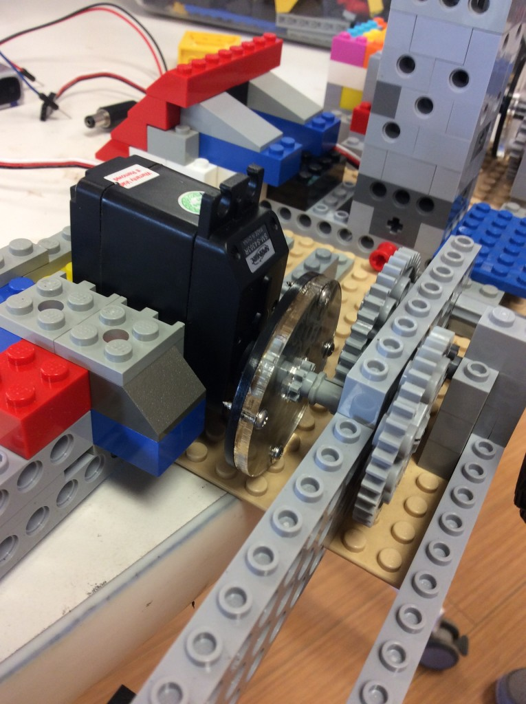 Using the laser cutter to make custom pieces to adapt LEGO to real servo motors.