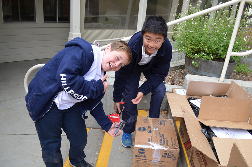 6th grade students pack books to send to fill a library in Malawi, Africa, as a part of this year's African Library Project